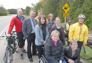 Safe cycling advocates mark the installation of Share the Road signage in Huron County.