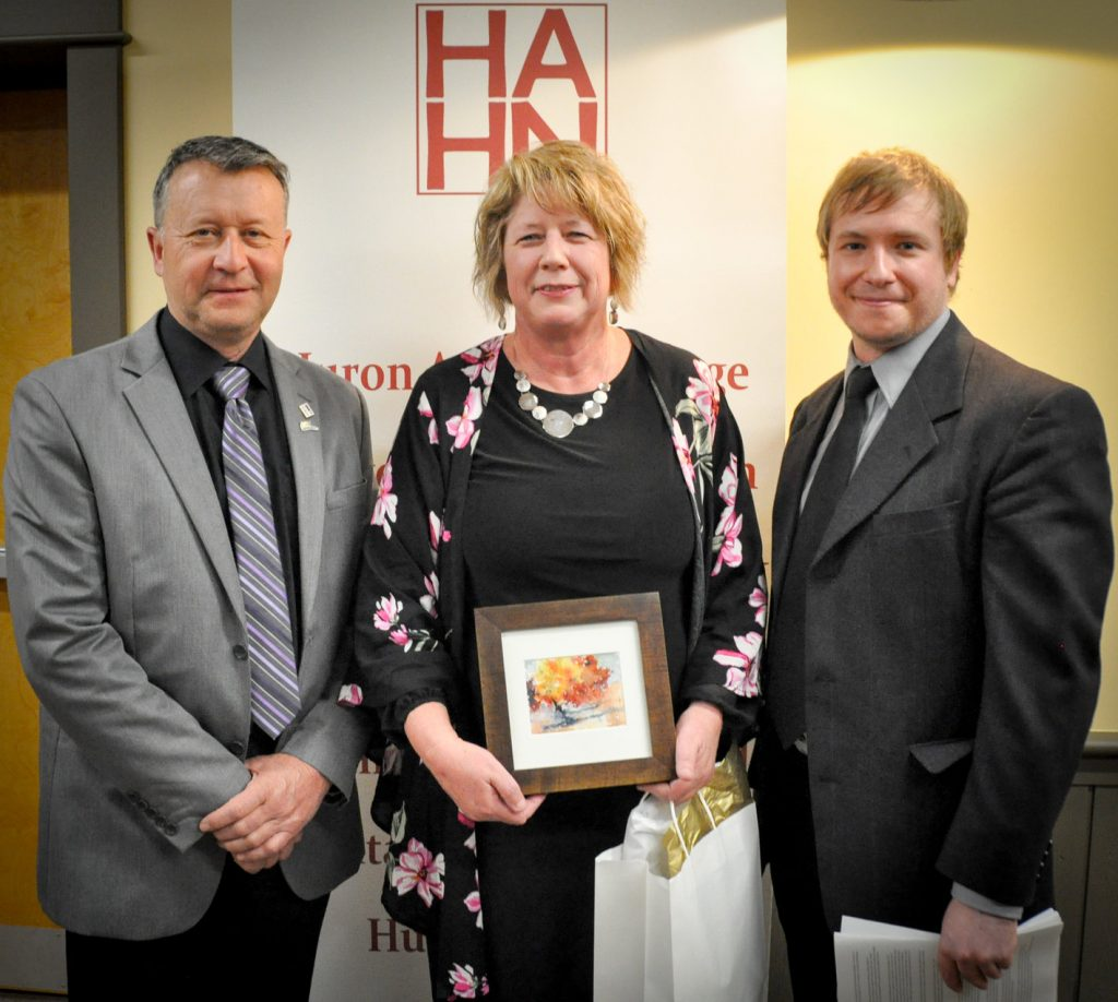 Warden, Jim Ginn with the 2018 Wardens Award Winner Jacquie Bishop and Huron Arts and Heritage Network Chair Aaron Neeb.