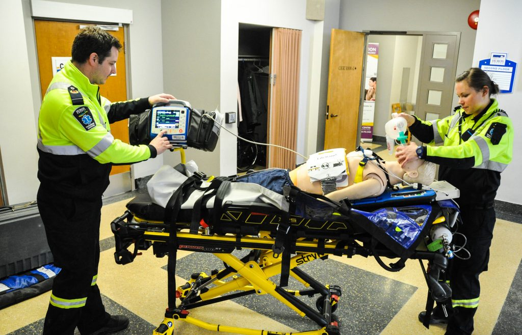 Zoll AutoPulse Committee Presentation (17of17).jpg - Huron County Paramedics, Adam Robinson and Cassie Crawford, demonstrate how the Zoll Medical AutoPulse Resuscitation System works.