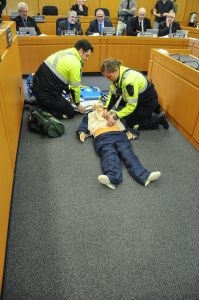 Huron County Paramedics, Adam Robinson and Cassie Crawford, give a demonstration of the Zoll Medical AutoPulse Resuscitation System in the Huron County Council Chambers at Committee of the Whole Day two.